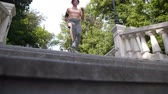 závazek : Mature redhead female jogging down the stairs