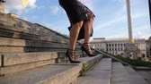 Businesswomans legs in heels stepping down stairs