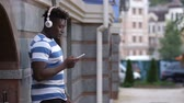 sulco : Man with headphones listening music on smart phone Stock Footage