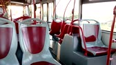 A ride inside a red public bus which is starting its route