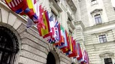 palácio : ,International flags from OSCE and several nations waving in the wind in front of a historical building Stock Footage