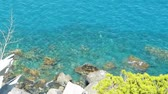 ,Rocky mediteranean sea shore with cristal clear blue water and soft waves