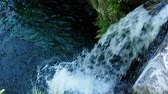 Waterfall and river outdoors panning shot with stream or flow in National Park Stock Footage