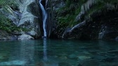 Cascade flowing in panorama shot at Val Grande National Park Stock Footage