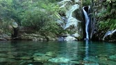 Waterfall in a rock with water stream in Val Grande Stock Footage