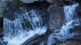 Water goes with the flow through rocks in river or creek