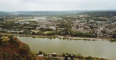 Aerial tracking shot around the Erpelery Ley with a view of the River Rhine and the city of Remagen (4K)