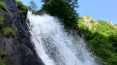 Waterfall in mountain landscape during a summer day (HD) Stock Footage