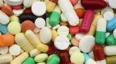 eczacı : Closeup shot of a colorful selection of pills spinning (HD)