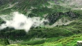 hilly : Loop of a mountain panorama from the French Alps with green fields and scenic landscape (HD) Stock Footage