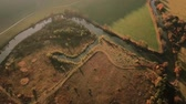 способ : Aerial tracking shot of autumn landscape with river and surrounding countryside Стоковые видеозаписи