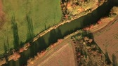 německo : Tracking top view shot of river walking through german countryside in autumn
