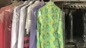 服 : Many clothes moving on rack in dry-cleaning laundry (Full HD)