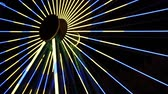 カーニバル : Yellow and blue light on a ferris wheel at a carnival at night (HD)