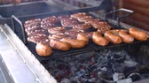 grill marinade : Steaks and sausages on the grill with flames. Turn the meat over. Food in nature