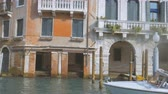 arcada : the boat sails through the Grand Canal in Venice