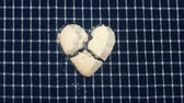 corazon partido : Top view animation broken heart cookie splitted by lightning