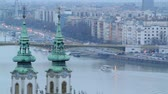 маргарита : Fast forward video of the traffic on Margaret Bridge in Budapest Hungary. St.Anna Church can be seen on the foreground. Blue hour in the evening, two scenes.