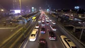 commute : Time lapse video of a rush hour traffic flow at night in Mecidiyekoy, Istanbul, Turkey.  Stock Footage