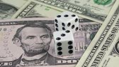 Dices on dollar investments swiftly rotating under studio lighting symbolising the risk factor on dollar investments Vídeos