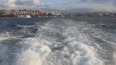 Crossing the Bosphorus Strait at the back of a passenger boat in Istanbul Turkey. Looking through the East part of the city, Uskudar district. Half speed slowed down from 50p to 25 p.