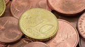 Euro cent coins macro rotating swiftly under the studio lighting