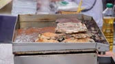 Cooking steak on side road market. Thailand Street Food. Stok Video