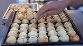 Cooking Takoyaki on side road market. Thailand Street Food.
