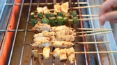 грибы : Sichuan pepper barbecue on grill grate at market street food.