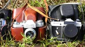 reflexo : RUSSIA, city Lipin Bor, July 8, 2016: slow camera review of the firm Zenith brand FED5v, 3M and ET in a leather case