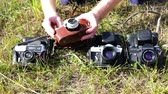 reflexo : RUSSIA, city Lipin Bor, July 8, 2016: Display and demonstration of professional old camera Zenit3M legendary firm in a brown leather case Stock Footage