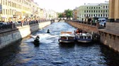 curso : two jet skis float on the Griboyedov Canal in the city center