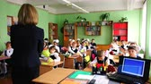 kötelező : The teacher meets first-grade children in an open lesson on September 1
