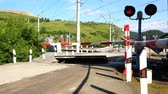 дорожный знак : freight train approaching a closed railway crossing
