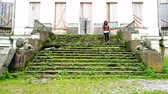 longevity : lonely girl down the grass-covered steps