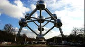 signage : Belgium, November 24, 2017, Brussels Tourists pass by the monument Atomium
