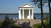 piety : Russia, July 16, Vyborg Tourists at the Temple of Neptune in Mon Repos Park Stock Footage