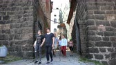 normandiya : tourists walking through the ancient fortress of knights times