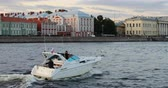 ponte : Russia, St. Petersburg, September 02 2018 a small boat with tourists runs along the city embankment.