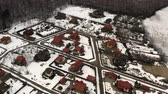 holiday plots and new houses in residential area with bright maroon roofs. Стоковые видеозаписи