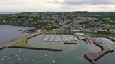 пришвартованный : Aerial view of Howth Harbour and village, Ireland