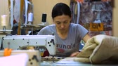 yoksulluk : Russia-October 26: Textile workers in a small factory in Krasnodar on October 26, 2017. The textile industry, the girls at the sewing machine. Stok Video