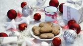Рождественский подарок : Christmas decoration with silver gifts red bubbles and home-made cookies,red light and milk