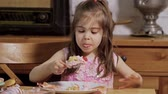 magdalenas : little girl decorates and eats delicious cupcakes