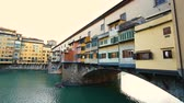 Side view at sunset of Ponte Vecchio in Florence, Italy. Stok Video
