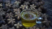 nut : Sacha seed pouring in hot tea slow motion