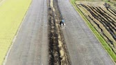 grain growing : Aerial view of truck plowing in the field Stock Footage
