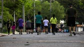 lumpini : Time lapse of people jogging in the park