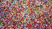 magnification : Colorful of sugar ball in slow motion