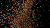 magnification : Colorful of sugar ball in slow motion abstract background